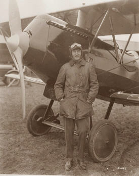 Beech with an early Travel Air open-cockpit biplane, c.
